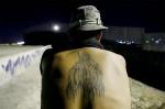 """fedelissimi con la """"Santa"""" tatuata sulla schiena"""