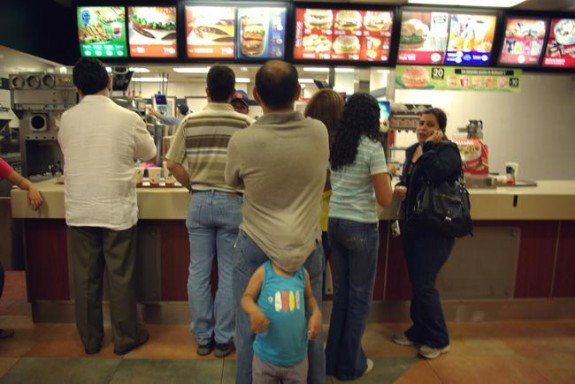 People waiting at Mc donalds and a child playing with his dad - Anahita Avalos, France